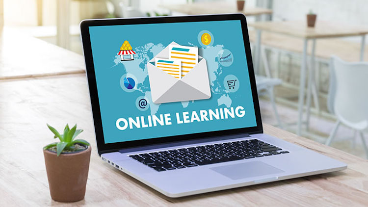 """Image of a computer with the text """"online learning"""" on the screen."""